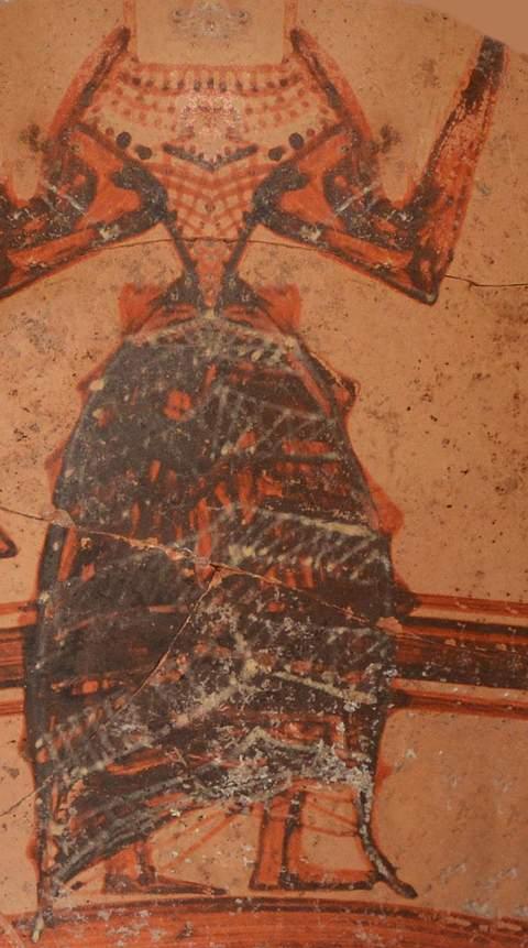 En una vasija micénica aparece pintada una diosa minoica, con un vestido muy elaborado.